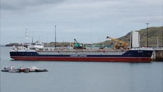 Alderney Harbour cranes and Alderney Shipping boat Valiant