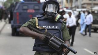 A Nigerian policeman holds a teargas launcher in Lagos on 1 June 2012