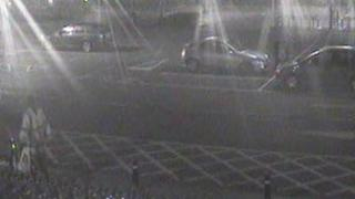CCTV image of a man with a bike in the bottom left of the picture