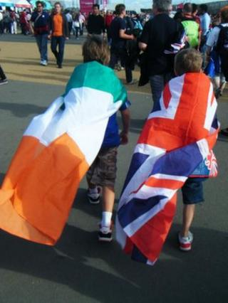 Child wrapped in Irish tricolour, another wrapped in Union flag