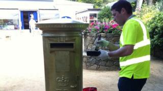 Sark's only post box being painted gold to mark Carl Hester's Olympic success in Team GB's dressage