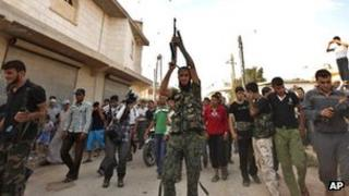 Rebel fighters at funeral in Aleppo. 9 Aug 2012