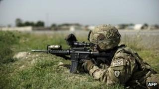 An Isaf soldier takes aim in Afghanistan (file image)