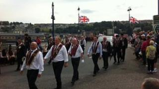 The parade makes makes its way around the city centre