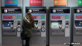 Lady buys a ticket at Clapham Junction
