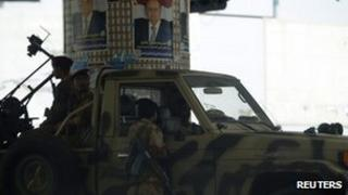 """Army soldiers are positioned on a street near the Defence Ministry""""s compound in Sanaa"""