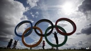 Children play on the Olympic rings at the rowing venue in Eton Dorney, near Windsor, England
