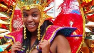 Dancer takes part in Nottingham's Caribbean carnival parade through Nottingham's city streets to the Forest Recreation Ground on 14 August 2011