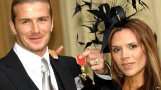 David Beckham with his OBE and wife Victoria Beckham