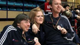 Peter McGuire, Carer (Ruth Thomson) and Stephen McGuire with their Bronze Medals after the Boccia International Tournament in Portugal.
