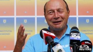 President Basescu addresses the media in Bucharest (File)