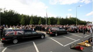 The cortege of three hearses passed through Carterton in Oxfordshire