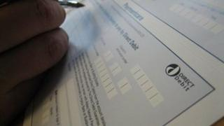 Direct debit form being filled in