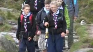 Scouts carrying miner's lamp