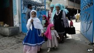 Women wearing the clothes required by the dressing code of the New Jerusalem religious community in Michoacan state, Mexico.