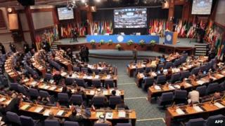 Official delegations attend the opening session of the expert-level meeting of XVI summit of the Non-Aligned Movement in Tehran on August 26, 2012.