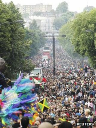 Festival-goers attending the Notting Hill Carnival fill Ladbroke Grove in west London August 27, 2012