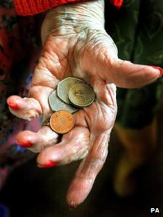 Older woman's hand holding coins