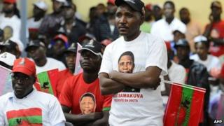 Unita supporters listen to a speech by their leader Isaias Samakuva on 29 August 2012 in Luanda during the final rally before elections on Friday