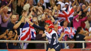 Sarah Storey takes a lap of honour in the velodrome