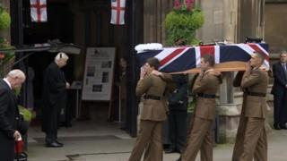 Lt Andrew Chesterman's coffin being carried into Bristol Cathedral