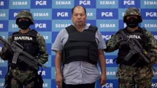 Mexican Navy officers flank Mario Cardenas Guillen