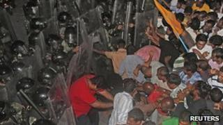 Supporters of former Maldivian President Mohamed Nasheed clash with soldiers during a protest in Male on 1 September