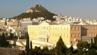 Lycabettus Hill in Athens, with the Greek parliament in the foreground