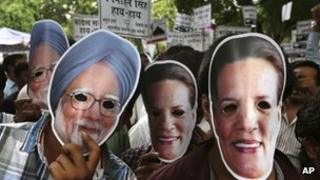 "India""s main opposition Bharatiya Janata Party (BJP)""s youth wing ""Bharatiya Janata Yuva Morcha"" activists wear masks of Prime Minister Manmohan Singh, left, and Congress party chief Sonia Gandhi, right, as they protest a scandal over the government""s sale of coal fields without competitive bidding in New Delhi, India, Wednesday, Aug.29, 2012."