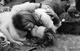 Couple kissing at 1960s festival in Hyde Park