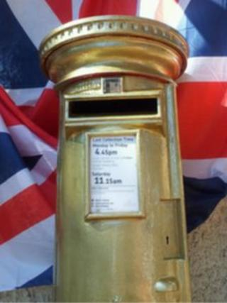 Deb Criddle's gold postbox in Trull, Somerset