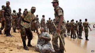 Indian police officers detain a protestor after they baton charged residents protesting against the Russian built Kudamkulam nuclear plant on the Bay of Bengal coast at Kudamkulam, Tamil Nadu state, India, Monday, Sept. 10, 2012.