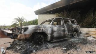 A burnt car at the US consulate in Benghazi which was attacked by gunmen