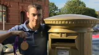 Josef Craig with gold postbox