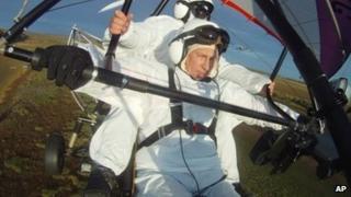 Russian President Vladimir Putin flies in a motorized hang glider alongside a Siberian white crane (image from 5 Sept)