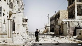 Syrian rebel fighter in ruined Aleppo