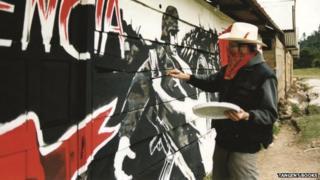 Banksy painting a mural