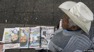 Newspaper vendor in Guatemala