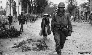 American soldiers and Vietnamese refugees returning to the town of Hue, in Vietnam