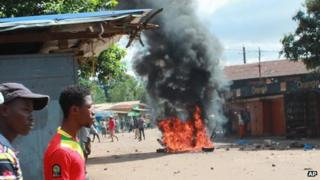 A fire burning in Conakry's main market during clashes on Friday 21 September 2012