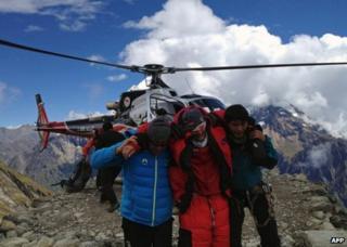 Nepalese rescuers help a foreigner injured on Mount Manaslu, 23 September