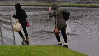 These ladies braved the bad weather by pulling up their hoods