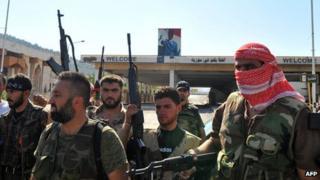 Rebels at the Bab al-Hawa border crossing
