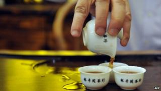Tea poured into Chinese tea cups