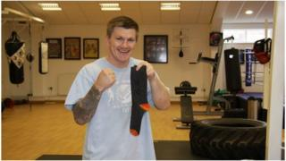 Boxer Ricky Hatton with a sock