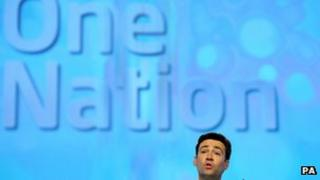 Shadow health secretary Andy Burnham speaking under Labour's new slogan at the conference