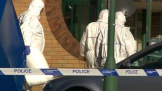 Forensic officers at a bloc of flats in Walsall