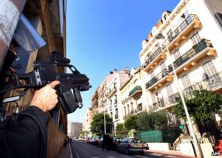 A French policeman stands guard in Cannes during an anti-terrorist operation, 6 October