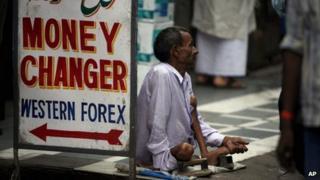 A man begging in Delhi, India