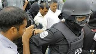 Members of the Maldivian police arrest former Maldives president Mohamed Nasheed (handout photograph from the Maldivian Democratic Party)